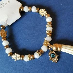 White Hamsa bracelet with gold colors
